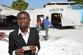 Francois Alexis, 24, holds his voter registration card in the Cite Soleil slum during the first round of voting in the 2011 Haiti election. Despite being registered, Alexis was unable to vote as he was unable to find the appropriate polling station.