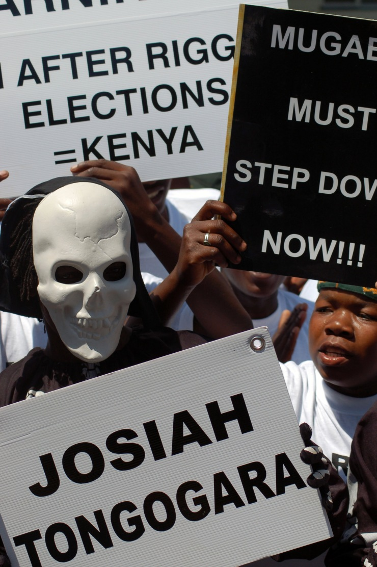 Exiled Zimbabweans protest outside the country's consulate in Pretoria, South Africa