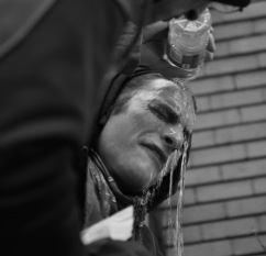 A protester washes chemical gas from his eyes during student protests in Montreal.