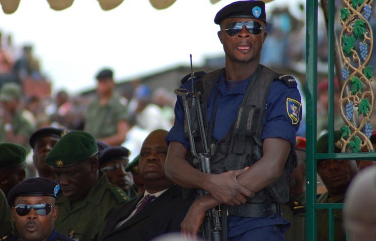 Police guard dignitaries during a military parade in Eastern DRC