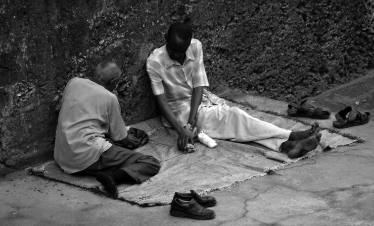 Men play cards in Mobasa, Kenya during the post-election violence that consumed the nation in 2009.