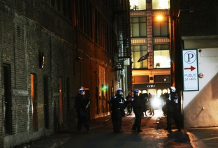 Police regroup in an alley in downtown Montreal at the height of protests against a Quebec government attempt to raise tuition rates.