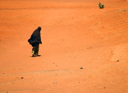 A woman walks though a dried up lake bed along the Kenya-Somalia border. Severe drought has affected the area for years.