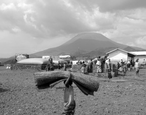 A child carries a bed roll in the KIbati II refugee camp outside Goma in the Eastern DRC