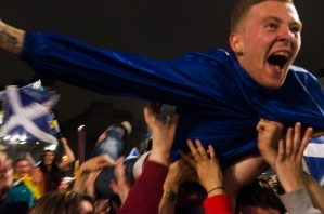 A 'yes' supporter crowdsurfing in George Square, Glasgow as Scots awaited results on referendum night.