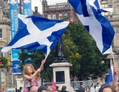A young girl waves the Scottish flag on referendum day in George Square, Glasgow.
