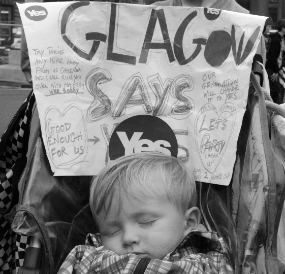 A child sleeps in George Square the day following the referendum. Many voters in Scotland's largest city have vowed to punish the ScottishLabour party for it's opposition to independence.