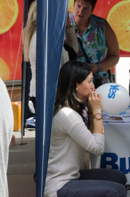 A woman blows up 'yes' campaign balloons in central Glasgow on the eve of the Scottish referendum.
