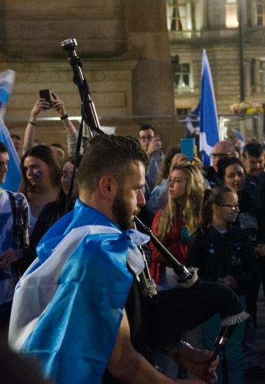 A bagpiper walks through George Square, Glasgow on referendum night.
