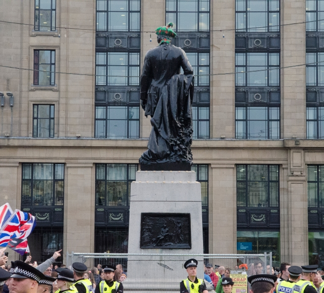 A statue of the Scottish poet Robbie Burns in George Square. In what has become a Glasgow tradition, the statue sports new attire the day following the referendum.