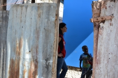 Red Cross manager Erin Grinnell tours an earthquake-destroyed village near Leogane, Haiti