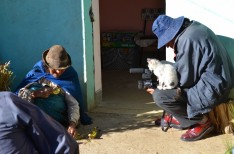A man films a documentary in rural Bolivia.