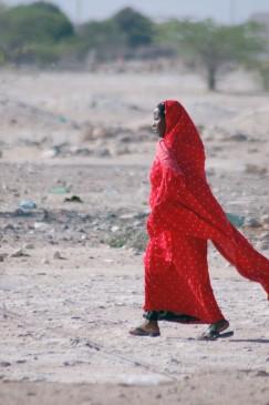 A woman walks to the market in Wajir, Kenya