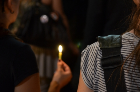 A woman holds a candle during the aftermath of a shooting in Montreal.