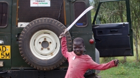 A child playfully brandishes a machete in Western Kenya at the height of the country's post-election violence.