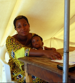 A woman and her child sit in a tent in a Congolese displacement camp. The mother and her child had been separated for weeks after fleeing fight in North Kivu. They were re-united by a UNICEF program.
